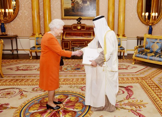 Queen Elizabeth II shakes hands with His Excellency Shaikh Fawaz bin Mohamed Al Khalifa the Ambassador of Bahrain, before he presents his Letters of Credence at a private audience in Buckingham Palace, in central London.